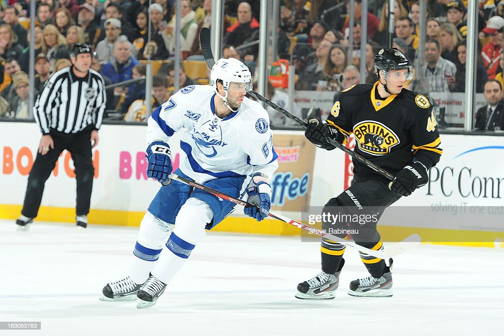 <a gi-track='captionPersonalityLinkClicked' href=/galleries/search?phrase=Benoit+Pouliot&family=editorial&specificpeople=879830 ng-click='$event.stopPropagation()'>Benoit Pouliot</a> #67 of the Tampa Bay Lightning skates against <a gi-track='captionPersonalityLinkClicked' href=/galleries/search?phrase=David+Krejci&family=editorial&specificpeople=722556 ng-click='$event.stopPropagation()'>David Krejci</a> #46 of the Boston Bruins at the TD Garden on March 2, 2013 in Boston, Massachusetts.