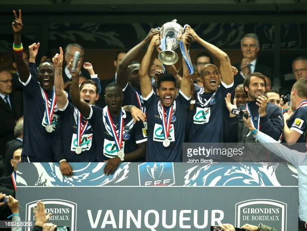 Benoit Tremoulinas and Carlos Henrique lift the winners trophy with their teammates Ludovic Sane Henri Saivet Marc Planus after the French Cup Final...