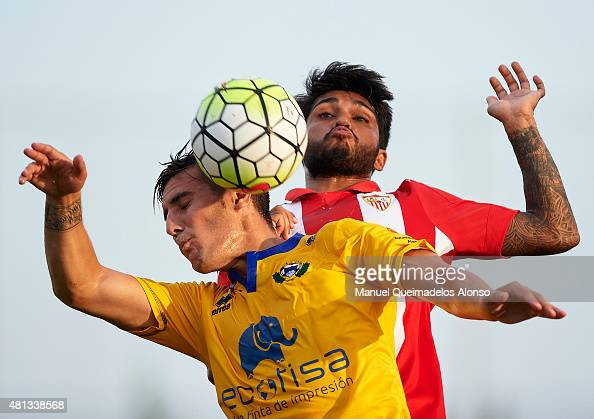 Benoit Tremoulinas of Sevilla battle for the ball with Sergio Guardiola of Alcorcon during a Pre Season Friendly match between Sevilla and Alcorcon...