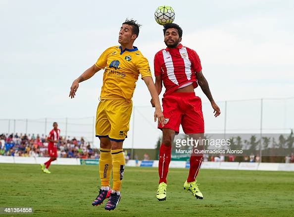 Benoit Tremoulinas of Sevilla battles for the ball with Sergio Guardiola of Alcorcon during a Pre Season Friendly match between Sevilla and Alcorcon...
