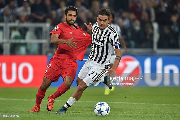 Benoit Tremoulinas of Sevilla is pulled by his shirt by Paulo Dybala of Juventus during the UEFA Champions League group E match between Juventus and...