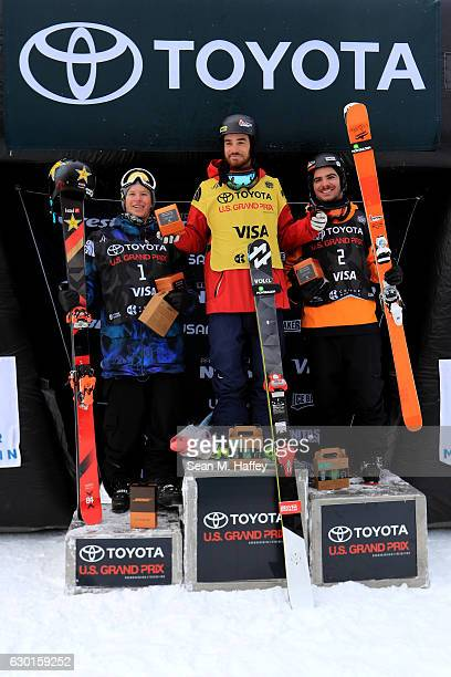 Benoit Valentin of France in second place Kevin Rolland of France in first place and Aaron Blunck in third place celebrate on the podium during the...