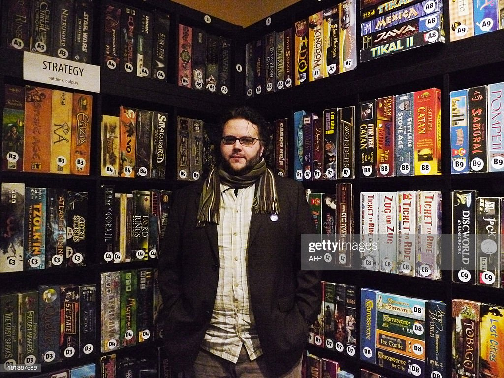 Benoît Castanié, the happy French founder and owner of Snakes and Lattes, a famous board game café in Toronto, is pictured Debruary 2, 2013. Since its opening in 2010, people are queuing in the street to get a chance of trying one of 2500 games stocked on its shelves. AFP PHOTO / Thibault JOURDAN