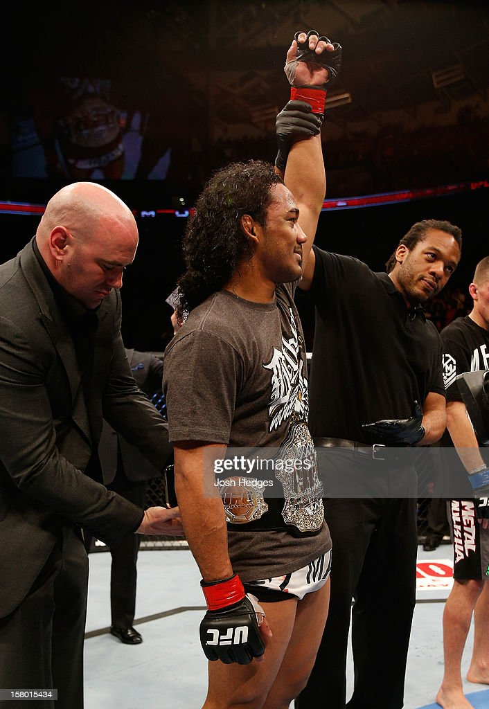 Benson Henderson has his hand raised after his victory over Nate Diaz in their lightweight championship bout at the UFC on FOX event on December 8, 2012 at Key Arena in Seattle, Washington.