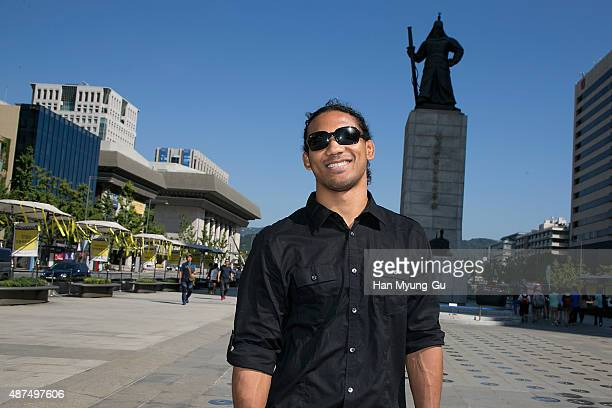 Benson Henderson poses in front of a statue of Admiral Lee SoonShin on September 10 2015 in Seoul South Korea