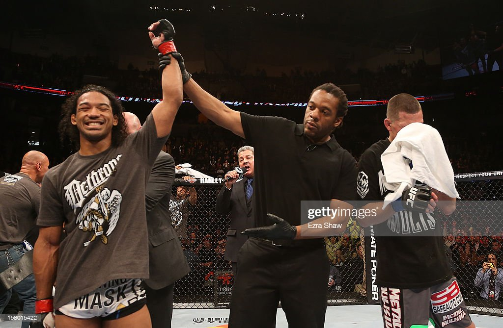 Benson Henderson (left) reacts to his victory over Nate Diaz (right) after their lightweight championship bout at the UFC on FOX event on December 8, 2012 at Key Arena in Seattle, Washington.