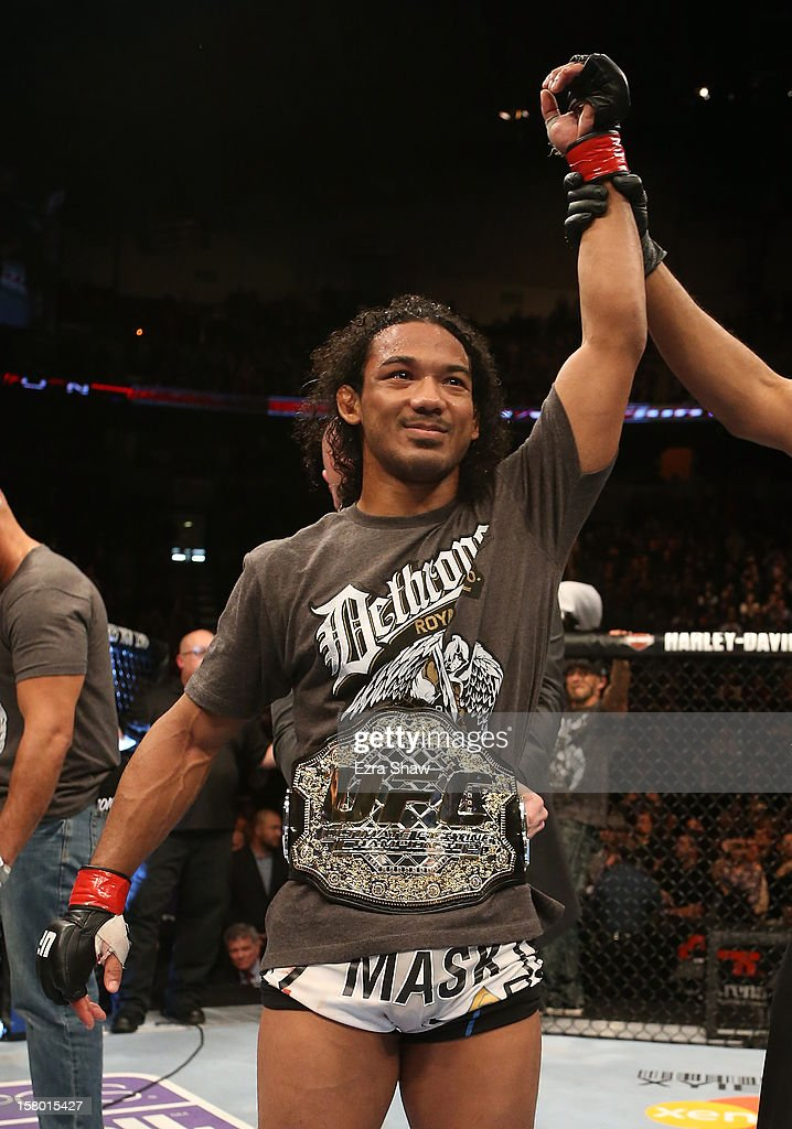 <a gi-track='captionPersonalityLinkClicked' href=/galleries/search?phrase=Benson+Henderson&family=editorial&specificpeople=8623964 ng-click='$event.stopPropagation()'>Benson Henderson</a> reacts to his victory over <a gi-track='captionPersonalityLinkClicked' href=/galleries/search?phrase=Nate+Diaz&family=editorial&specificpeople=5532032 ng-click='$event.stopPropagation()'>Nate Diaz</a> after their lightweight championship bout at the UFC on FOX event on December 8, 2012 at Key Arena in Seattle, Washington.