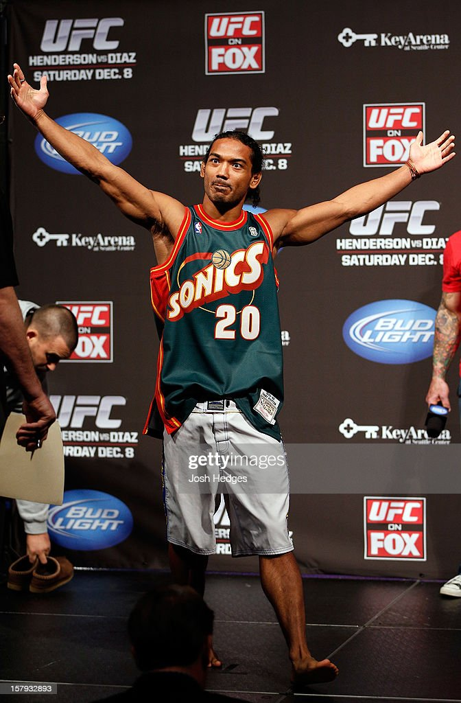 Benson Henderson stands on stage wearing a Gary Payton Seattle Sonics jersey during the official UFC on FOX weigh in on December 7, 2012 at Key Arena in Seattle, Washington.