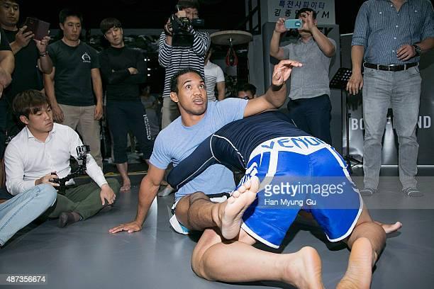 Benson Henderson teaches fans during an MMA workshop on September 9 2015 in Seoul South Korea