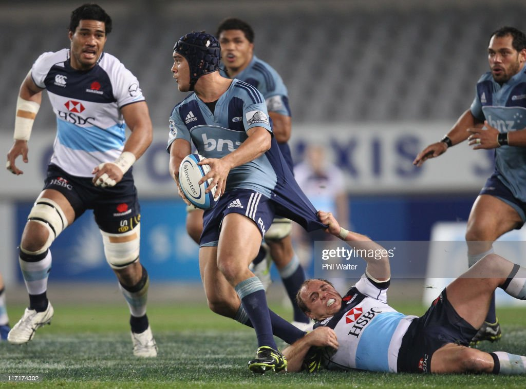 Benson Stanley of the Blues is tackled by Phil Waugh of the Waratahs during the Super Rugby qualifier match between the Blues and the Waratahs at Eden Park on June 24, 2011 in Auckland, New Zealand.