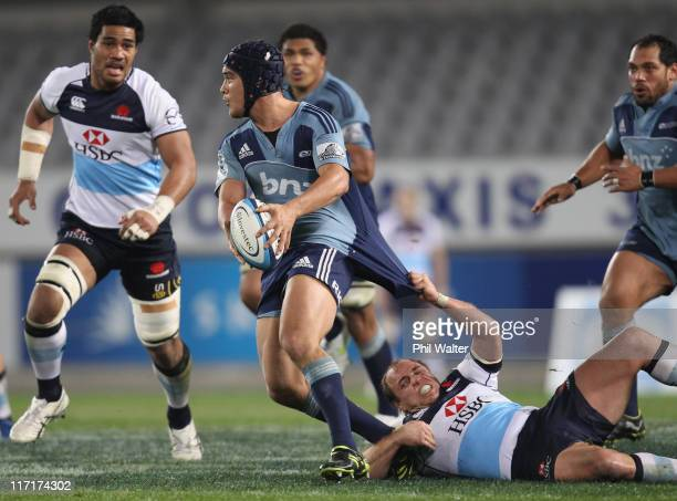 Benson Stanley of the Blues is tackled by Phil Waugh of the Waratahs during the Super Rugby qualifier match between the Blues and the Waratahs at...