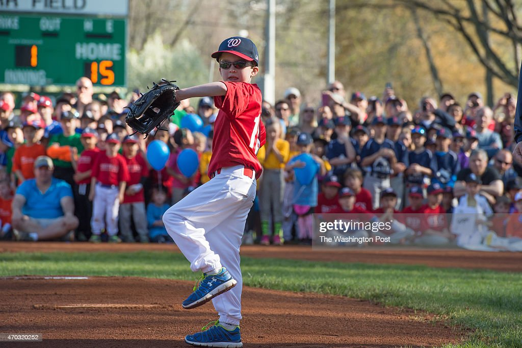 Bensten Schone throws out the first pitch to Washington Nationals player Jayson Werth at the opening day of Little League in McLean VA on April 18...