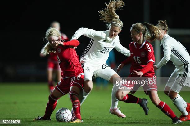 Bente Fischer of Germany and Mathilde Rasmussen of Denmark compete for the ball during the U16 Girls international friendly match betwwen Denmark and...