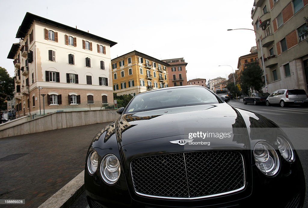 A Bentley automobile stands near residential apartment blocks in the Parioli district of Rome, Italy, on Wednesday, Jan. 2, 2013. Italian property sales often are reported to be less than the actual price paid to reduce taxes or skirt controls on money laundering, according to the website of the finance police, which reports to Italian Finance Minister Vittorio Grilli. Photographer: Alessia Pierdomenico/Bloomberg via Getty Images