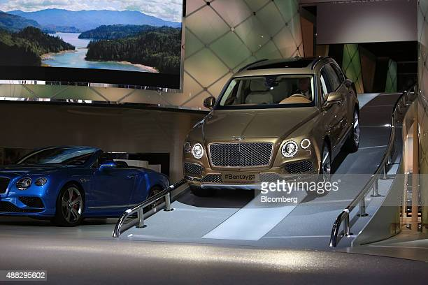 A Bentley Bentayga SUV automobile produced by Bentley Motors Ltd a luxury unit of Volkswagen AG is driven down a ramp at the IAA Frankfurt Motor Show...