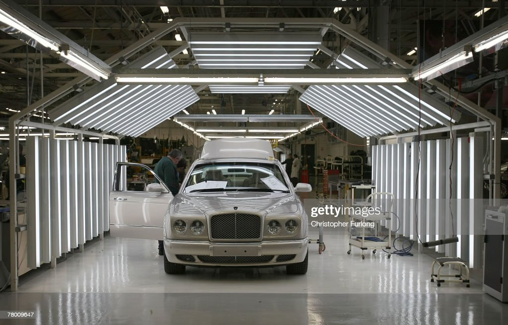 A Bentley car sits inside a light tunnel and undergoes final preparation and inspection in the Mulliner workshop at the Bentley Motors Factory on 19 November, 2007 in Crewe, England. The Cheshire based company has posted record results for the nine months to the end of September. World demand for the bespoke car has been boosted by new model launches such as the Continental GTC, the convertible version of the top-selling Bentley Continental, and the Azure, a convertible model of the hand-made Arnage. Bentley's major growth has been in China with 50 million GBP sales which is expected to double in the next two years. All cars are built to the customers own specification by craftsmen with final personal details added in the factory's Mulliner workshop.