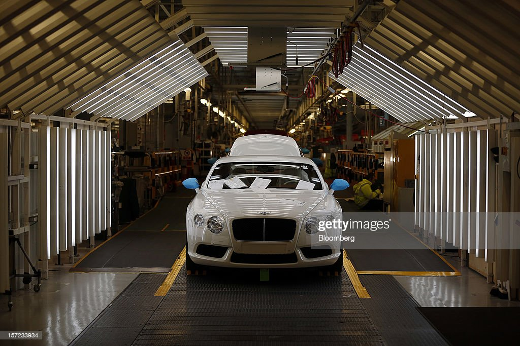 A Bentley Continental automobile sits inside an inspection chamber following completion at the Bentley Motors Ltd. workshop in Crewe, U.K., on Thursday, Nov. 29, 2012. Consumer spending and exports propelled the U.K. economy to its fastest growth since 2007 in the third quarter as the Olympics and a post-Jubilee rebound saw household expenditure rise the most in more than two years. Photographer: Simon Dawson/Bloomberg via Getty Images