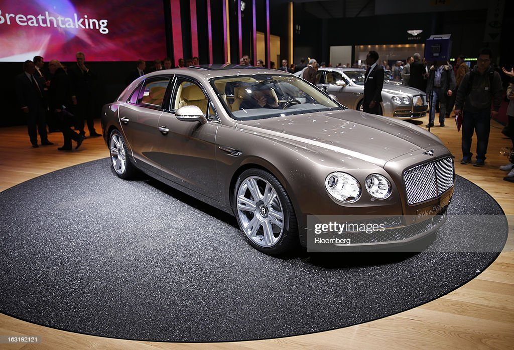 A Bentley Flying Spur automobile, produced by Bentley Motors Ltd., a luxury unit of Volkswagen AG (VW), is seen on display on the first day of the 83rd Geneva International Motor Show in Geneva, Switzerland, on Tuesday, March 5, 2013. This year's show opens to the public on Mar. 7, and is set to feature more than 100 product premiers from the world's automobile manufacturers. Photographer: Valentin Flauraud/Bloomberg via Getty Images