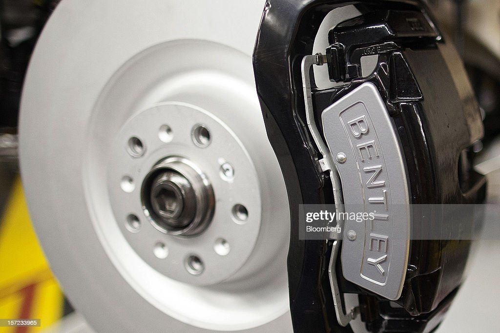 A Bentley logo sits on the brake caliper of a Continental automobile as it travels along the production line inside the Bentley Motors Ltd. workshop in Crewe, U.K., on Thursday, Nov. 29, 2012. Consumer spending and exports propelled the U.K. economy to its fastest growth since 2007 in the third quarter as the Olympics and a post-Jubilee rebound saw household expenditure rise the most in more than two years. Photographer: Simon Dawson/Bloomberg via Getty Images