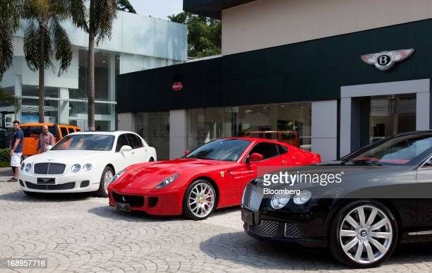 Bentley vehicles sit on display in front of a dealership on Colombia Street in Sao Paulo Brazil on Saturday April 27 2013 Retail sales in Brazil rose...