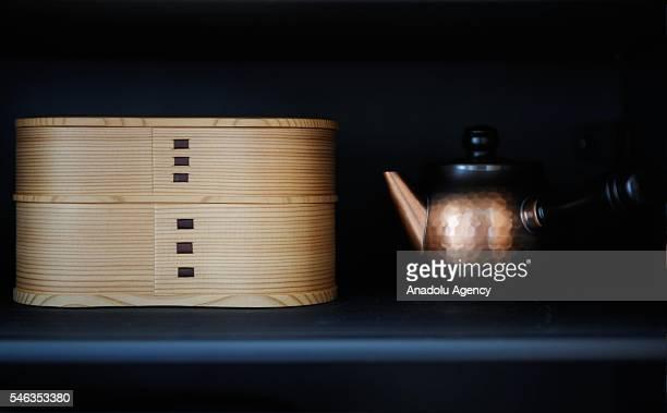 A bento box and a teapot are seen in the kitchen cupboard of minimalist Saeko Kubishiki in Fujisawa Kanagawa Prefecture in the southern of Tokyo...