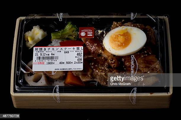 A bento box containing grilled chicken and vegetables from a convenience store or 'konbini' is pictured on September 11 2015 in Tokyo Japan Japan's...