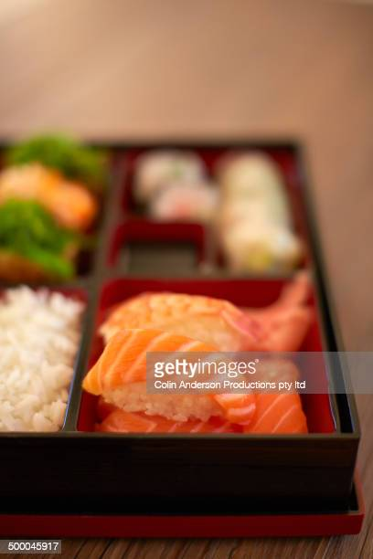 Bento box of sushi, rice and dipping sauce