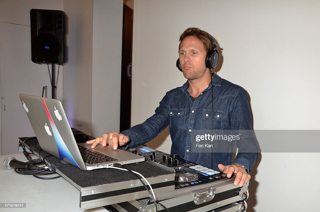 DJ Benwood performs during the 'Five Roads Back Home' Philipp Rathmer Photo Exhibition Preview at Galerie Joseph on June 20, 2013 in Paris, France.