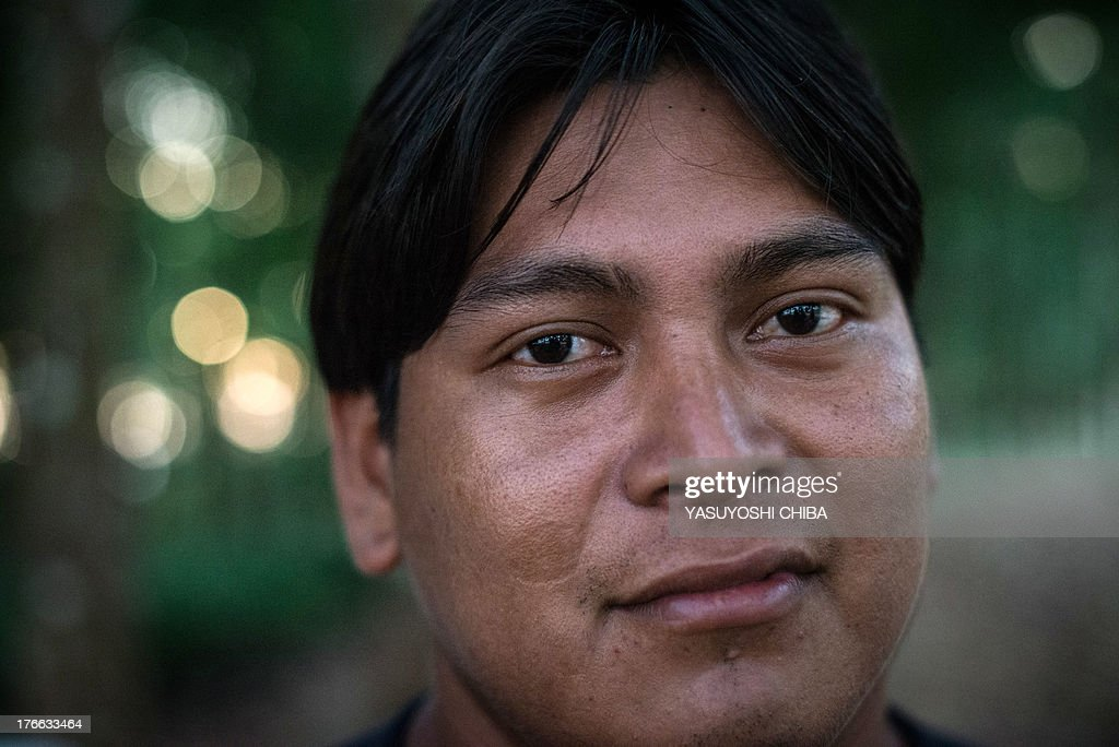 Bepkrwa, from Indio's Kayapo tribe, poses at the cacao seedling farm in Tucuma in Para state, northern Brazil, on August 8, 2013.