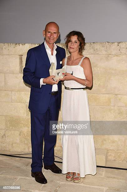 Beppe Ambrosini and actress Carlotta Natoli attend the 12th Salento Finibus Terrae sponsors by Baume Mercier at Borgo Egnazia on July 16 2014 in...