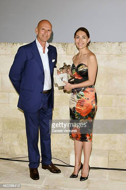 Beppe Ambrosini and actress Caterina Murino attend the 12th Salento Finibus Terrae sponsors by Baume Mercier at Borgo Egnazia on July 16 2014 in...