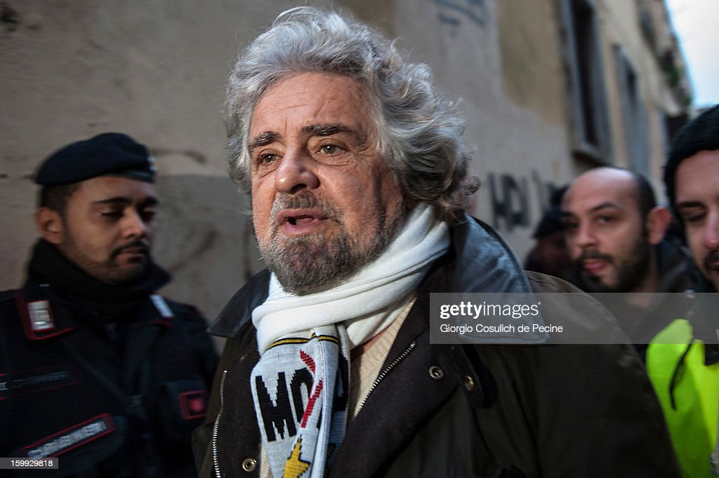 Beppe Grillo, founder of the Movimento 5 Stelle (Five Star Movement), arrives to speak during a public rally for the political campaign on January 23, 2013 in Pomezia, Italy. Grillo is touring all over Italy to promote the Five Star Movement at the next elections.