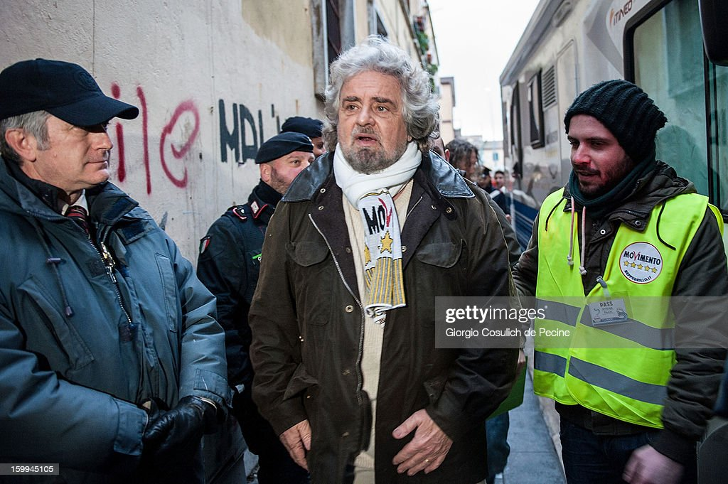 <a gi-track='captionPersonalityLinkClicked' href=/galleries/search?phrase=Beppe+Grillo&family=editorial&specificpeople=4246058 ng-click='$event.stopPropagation()'>Beppe Grillo</a>, founder of the Movimento 5 Stelle (Five Star Movement), arrives to speak during a public rally for the political campaign on January 23, 2013 in Pomezia, Italy. Grillo is touring all over Italy to promote the Five Star Movement at the next elections.