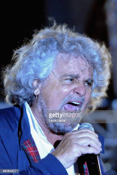 Beppe Grillo Italian comedian blogger and political leader of the Movimento 5 Stelle greets people after speaking during a political rally before the...