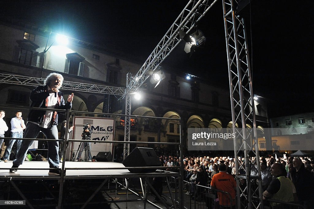 <a gi-track='captionPersonalityLinkClicked' href=/galleries/search?phrase=Beppe+Grillo&family=editorial&specificpeople=4246058 ng-click='$event.stopPropagation()'>Beppe Grillo</a>, Italian comedian, blogger and political leader of the Movimento 5 Stelle (Five Stars Movement or M5S), speaks during a political rally before the European election on May 21, 2014 in Florence, Italy. Elections will be held across Europe on Sunday 25th May where the electorate will vote for their EU members of Parliament.