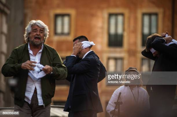 Beppe Grillo Luigi Di Maio and Alessandro Di Battista speak during a protest organized by Five Star Movement in front of the Pantheon against the...