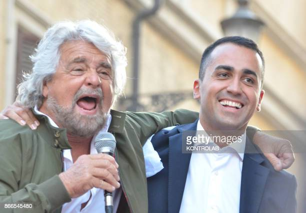 Beppe Grillo the comician founder of the Movimento 5 Stelle party and the House member Luigi Di Maio speaks during a protest against the new...