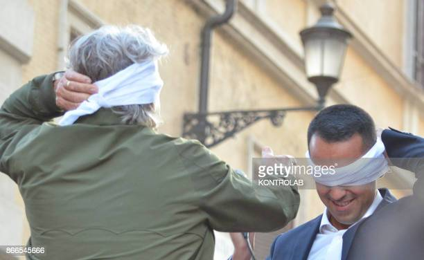 Beppe Grillo the comician founder of the Movimento 5 Stelle party and the House member Luigi Di Maio attend to ag a protest against the new electoral...