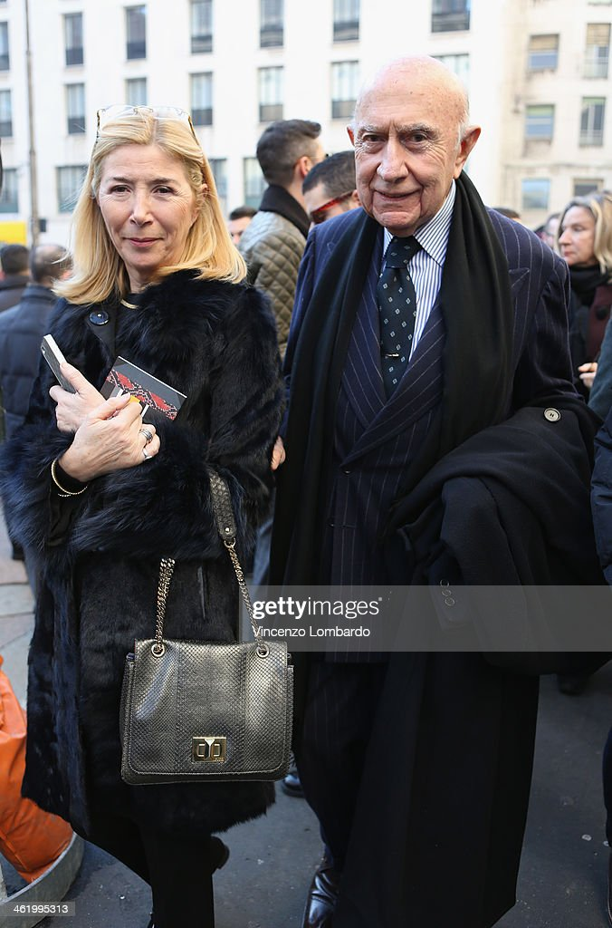 Beppe Modenese and guest are seen during Milan Fashion Week Menswear Autumn/Winter 2014 on January 12, 2014 in Milan, Italy.