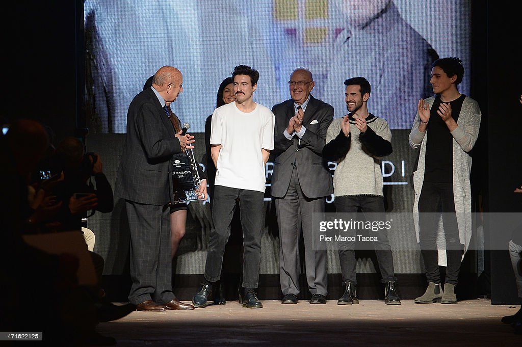 Beppe Modenese, Mario Boselli, Jane Reeve, winner of the contest Daniele Vigiani and group of young designers acknowledges the applause of the audience after the New Upcoming Designers as a part of Milan Fashion Week Womenswear Autumn/Winter 2014 on February 24, 2014 in Milan, Italy.