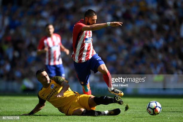 Beram Kayal of Brighton fouls Yannick Carrasco of Atletico Madrid during a Pre Season Friendly between Brighton Hove Albion and Atletico Madrid at...