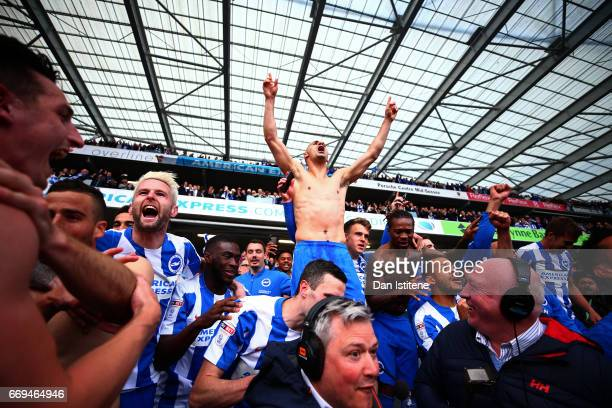 Beram Kayal of Brighton Hove Albion celebrates with teammates in the stands after victory in the Sky Bet Championship match between Brighton Hove...