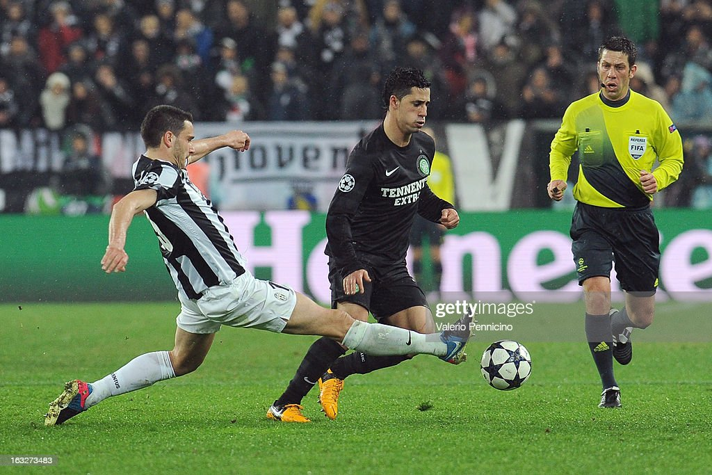 Beram Kayal (R) of Celtic is tackled by Leonardo Bonucci of Juventus during the UEFA Champions League round of 16 second leg match between Juventus and Celtic at Juventus Arena on March 6, 2013 in Turin, Italy.