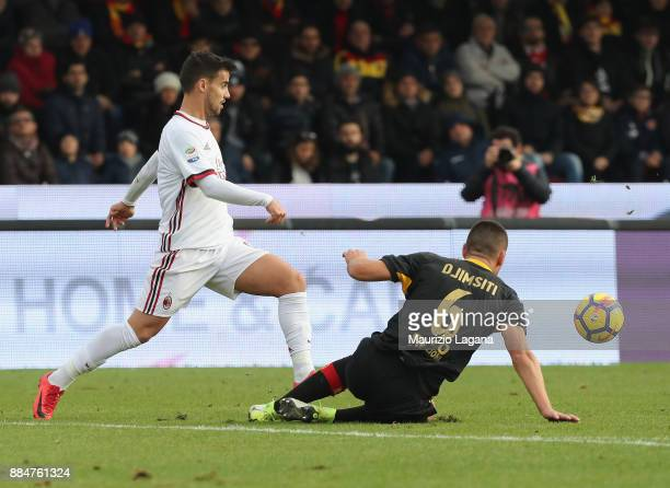 Berat Djimisiti of Benevento competes for the ball with Suso of Milan during the Serie A match between Benevento Calcio and AC Milan at Stadio Ciro...