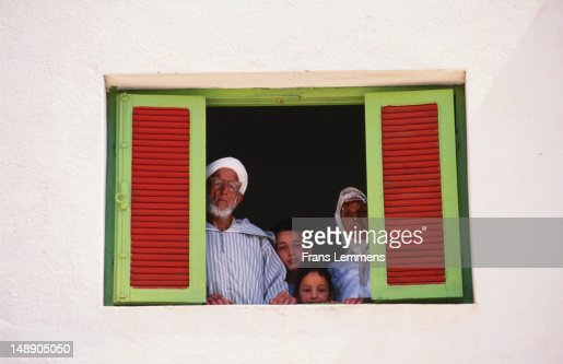 Berber family looking out window. : Stock Photo