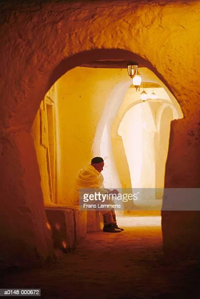 Berber Man Sitting in Corridor