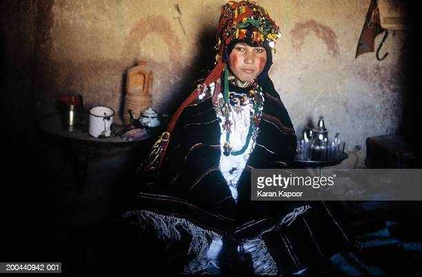 Berber tribeswoman wearing bridal costume, indoors, portrait