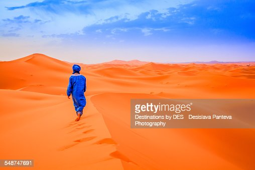 A Berber walking in the desert