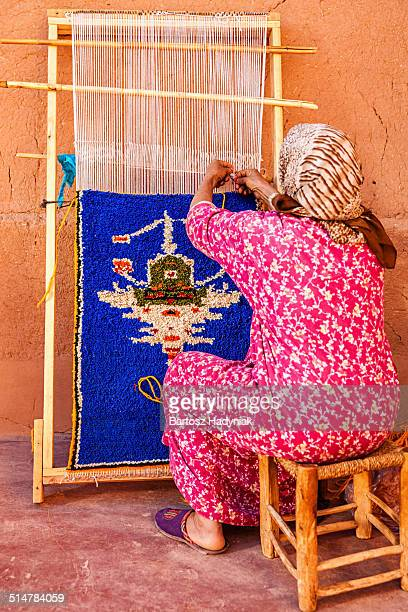 Berber woman weaving textiles near Ouarzazate