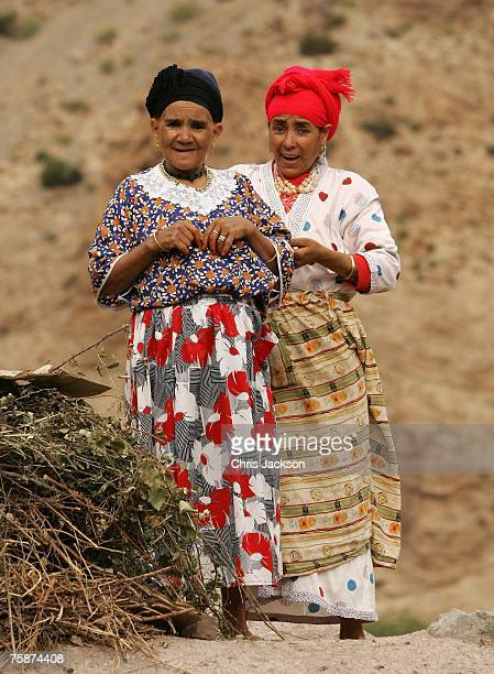 Berber women stand on the roof of a traditional Berber house in the village of Tisgui Ntknt on July 25 2007 in Imlil district Morocco Tisgui Ntknt is...
